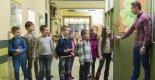 Male-teacher-students-hallway-classroom_560x292blog_Getty